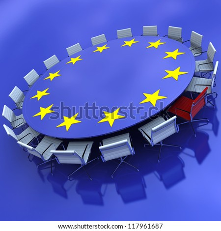 Round meeting table with the European symbol and a red chair - stock photo