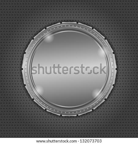 Round metal board on dark background - stock photo