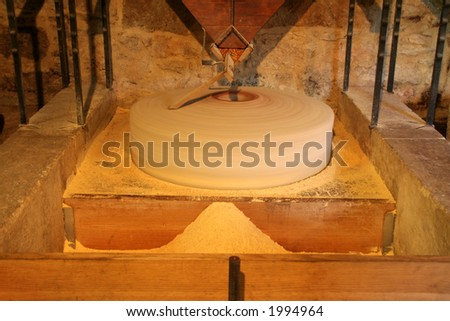 Round Mill Stone used in a mill to grind corn - stock photo