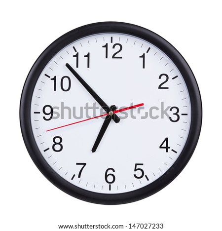 Round office clock shows almost seven o'clock - stock photo