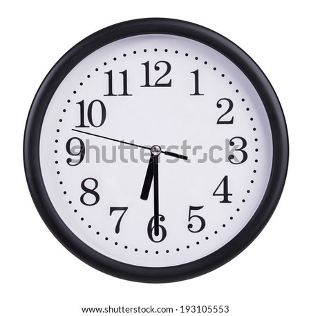 Round office clock shows half of the seventh - stock photo