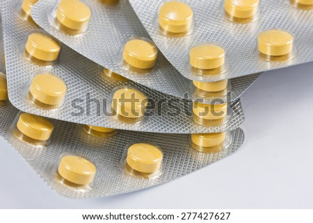 Round pills in Blisters - stock photo