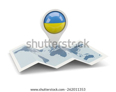 Round pin with flag of ukraine on the map - stock photo