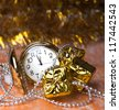 round, pocket watches are among the gifts,Christmas beads on the yellow - stock photo