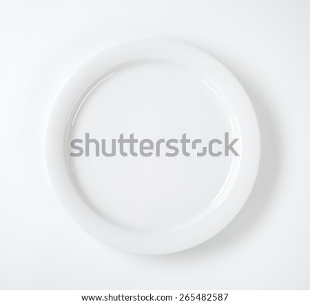 Round porcelain plate - stock photo