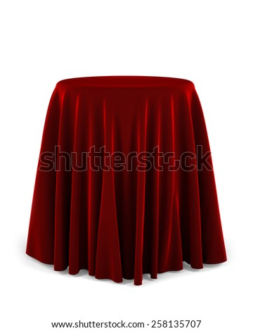 Round presentation pedestal covered with a red cloth over white background - stock photo