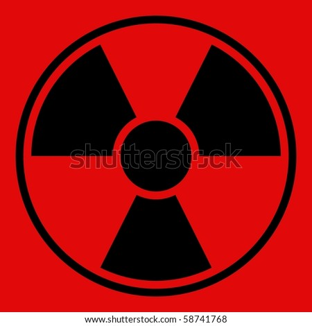 Round radiation warning sign on red background - stock photo