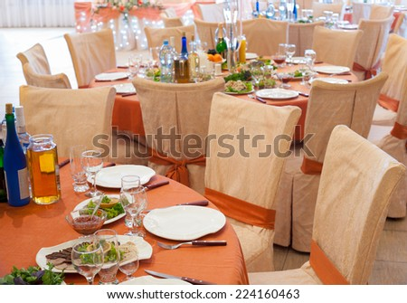 round restaurant tables laid and decorated for wedding party - stock photo