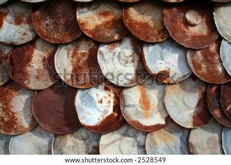 Round, Rusty Metal Plate Siding Background - stock photo