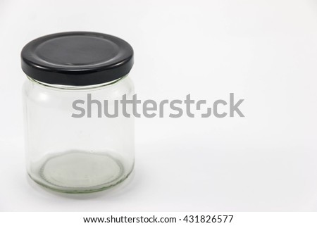 Round Shape Glass Canister isolated on white background - stock photo