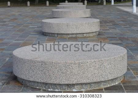Round stone benches. - stock photo