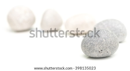 round stones isolated on a white background - stock photo