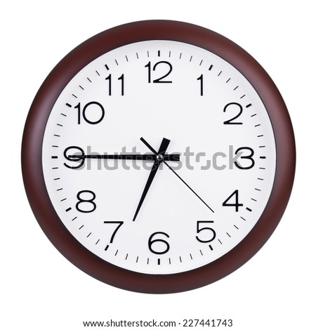 Round the clock shows a quarter to seven - stock photo