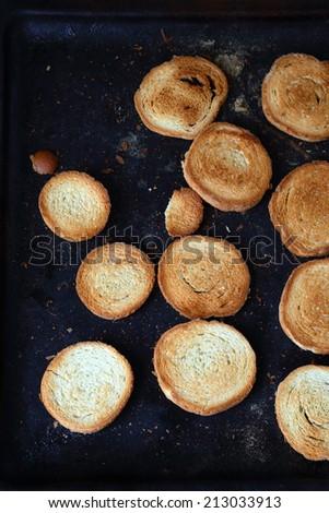 round toast on a baking sheet, food closeup - stock photo