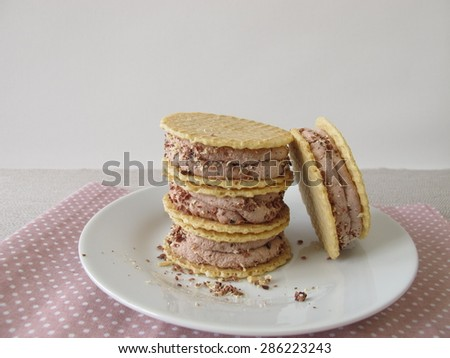 Round wafers with chocolate ice cream filling - stock photo