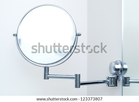 Round wall mirror for the bath. Close-up photo - stock photo