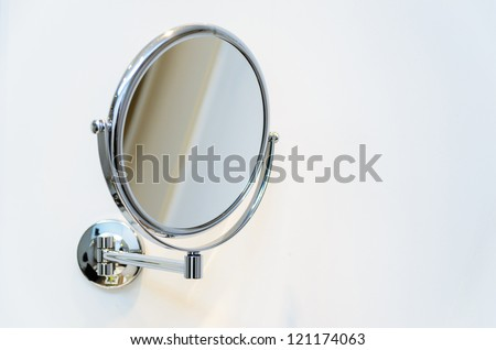 Round wall mirror for the bath. Photo Close-up - stock photo