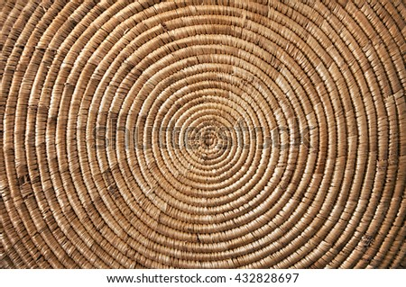 Round wicker woven fabric - stock photo