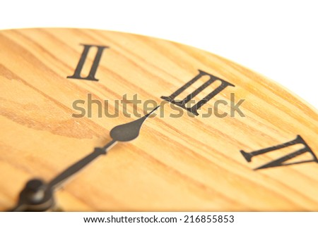 Round wooden clock close up - stock photo