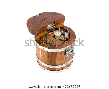 Round wooden money box with lock full with coins isolated on white background - stock photo