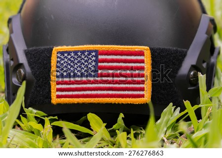 Rounded American flag patch stick on Special force Modern combat helmet with purple flower background - stock photo
