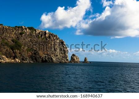 Rounding the corner of Norman island in the British Virgin Islands - stock photo