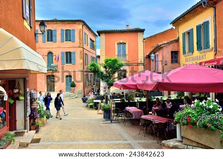 """ROUSSILLON, FRANCE - JUL 07, 2014: View on the small square of  medieval village Roussillon at evening. Roussillon ocher village is included in list of """"The most beautiful villages of France"""" - stock photo"""