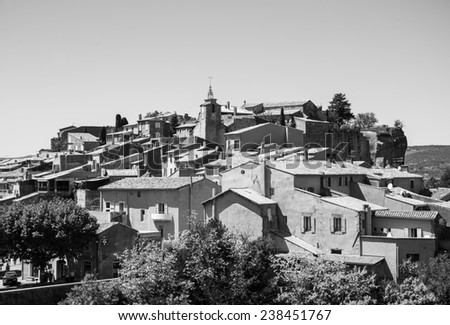 "Roussillon ocher village (included in the list of ""The most beautiful villages of France""). Provence Alpes Cote d'Azur, France. Aged photo. Black and white. - stock photo"