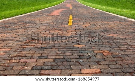 "Route 66: Auburn's Brick Road, a.k.a. ""Brick 66"", is a historical alignment containing the original bricks, near Auburn, Illinois. - stock photo"
