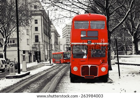 Route Master Bus on a snowy day, winter, London. - stock photo