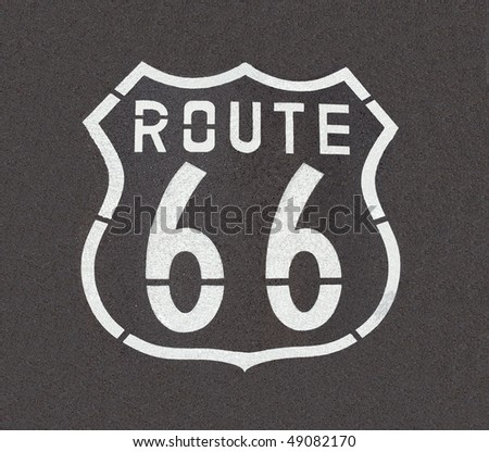 Route 66 pavement sign, straight down angle. - stock photo