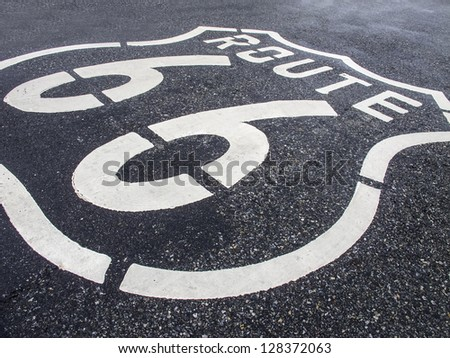 Route 66 Road sign painted into the road commemorating it's historical past. - stock photo