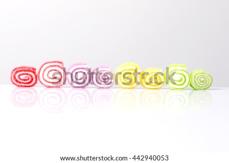 row colorful soft jelly gelatin candy isolated on gray background - stock photo