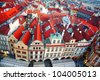 Row houses with traditional red roofs in Prague Old Town Square in the Czech Republic - stock photo