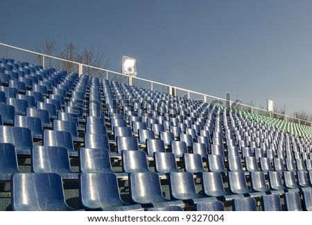 row of an empty seats and blue sky - stock photo