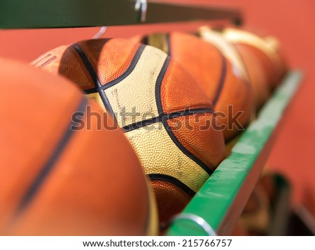 row of basket balls in gymnasium - stock photo
