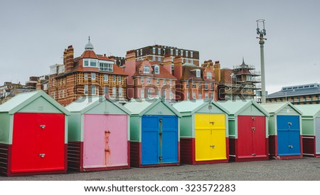 Row of beach huts of Hove in a cloudy day, Brighton, UK - stock photo