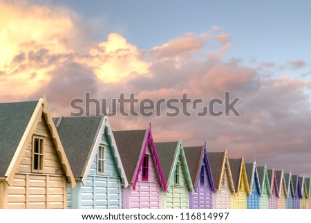 row of beach huts red sky - stock photo