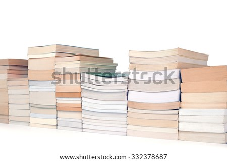 row of books on a white background oblique view - stock photo