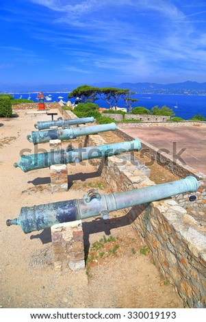 Row of bronze canons positioned on the walls of the Saint Tropez fortress, French Riviera, France - stock photo