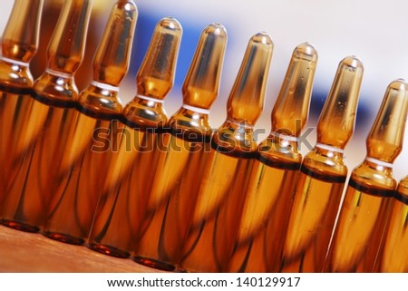 Row of brown vials filled - stock photo