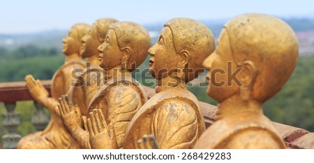 Row of Buddhist monk Statues in Thailand - stock photo