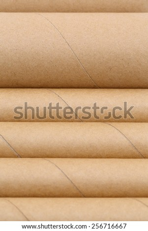 Row of cardboard cylinders  - stock photo