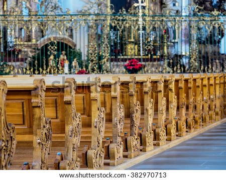row of chairs in a beautiful church in St. Gallen, Switzerland - stock photo