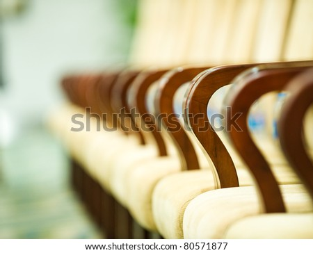 Row of chairs in boardroom.  Macro with extremely shallow depth of field. - stock photo