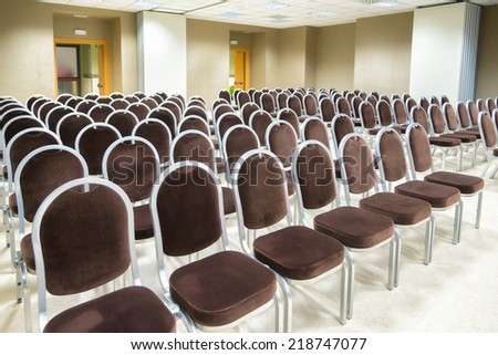 row of chairs in empty presentation room - stock photo