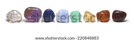 Row Of Chakra Crystals  -  Eight chakra colored crystals lined up in a row on a white background - stock photo