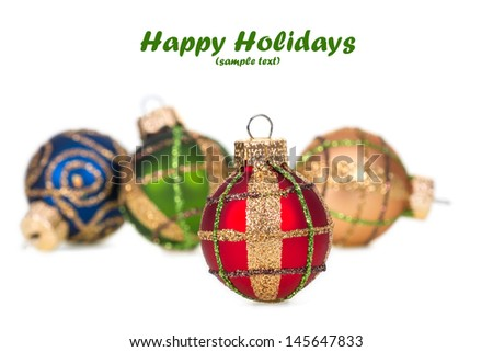 Row of Christmas balls isolated on white with copy space.  Shallow DOF.  - stock photo