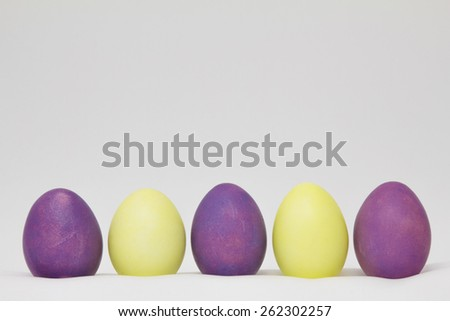 Row of colorful easter eggs on light background - stock photo