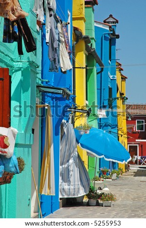 Row of colorful houses on the island of Burano, off of Venice. - stock photo